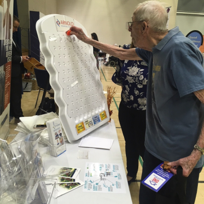 Trying Your Luck at Plinko During the Retire in Style Show