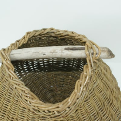 Organic basket with driftwood handle detail