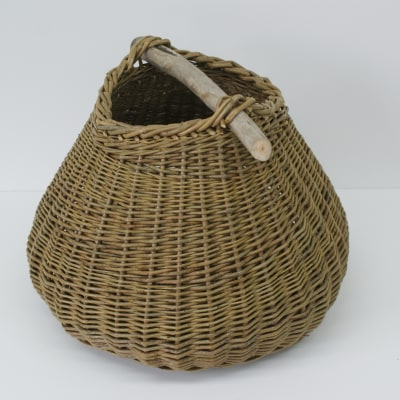 Organic basket with driftwood handle